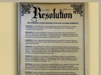 LAURA DEPRADO RECEIVES RESOLUTION